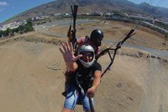 Feel the chilling breeze and warm sunshine and just fly like a bird in the blue sky. Fulfil  your dream of flying like a bird with paragliding. #adventuresports #paragliding #traveltotenerife