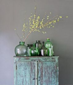 I love the country feel of this photo.  I could start a collection on top of my tv cabinet similar to this.