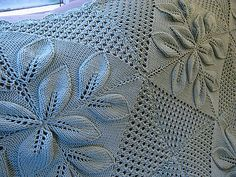 http://www.ravelry.com/projects/yarncycle/rug-with-embossed-leaves-2