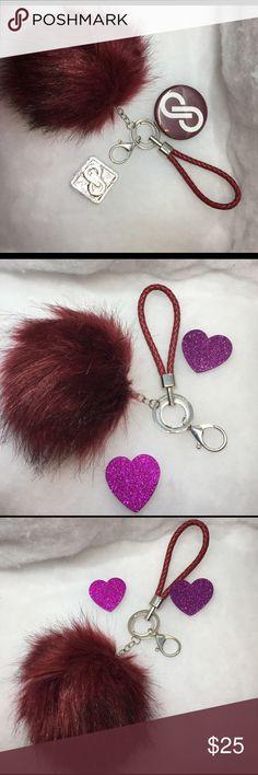 Pom Pom Key Chain/Bag Charm Burgundy NEW PomPom Bag Charm /Key Chain in burgundy color with leather hand strap brand New pompoms are all the rage💕Posh burgundy color posh Accessories Key & Card Holders