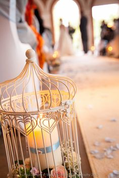 Birdcage candle holders with flowers - Great Fosters - StylishWeddingPhotograph.com