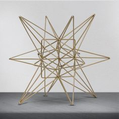 A star is born. Add some unique, stylish and contemporary home dcor accessories to your place like this metal star figurine. A beautiful network of gold painted metal lines intersects to create this attractive, impactful and gorgeous star cluster.