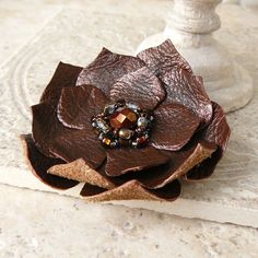 Love this, easy to do or buy here...http://www.etsy.com/listing/103629715/layered-fabric-flower-brooch-pin-in