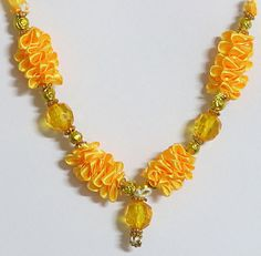 Yellow Ribbon and yellow Bead Small Garland for Deity (Beads and Ribbon))