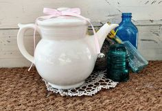 Check out this item in my Etsy shop https://www.etsy.com/listing/194687980/art-deco-teapot-antique-white-art