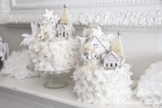 white flower cakes with snow scene toppers
