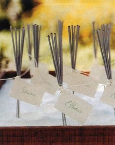 Take three to five sparklers, tie them together with a pretty ribbon, and add a tag of your guest's name. Be sure to include a book of matches! When it gets dark, the guests can play or save them for another day.
