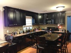 My updated kitchen! Painted cabinets and new backsplash/crown/removed soffett