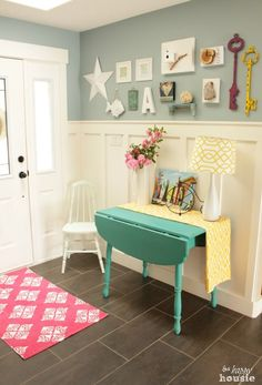 Cool decorating ideas! colorful and cheery entry hall part of a full lake cottage style summer house tour at The Happy Housie
