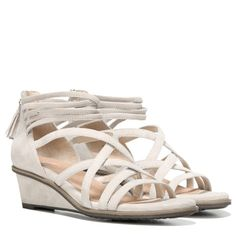 Dr. Scholl's Orig Collection Granted Wedge Sandal Greige Suede. A sandal that's pure you. Get this gorgeous sandal and its crisscrossed look for just right coverage. The striking straps will add a fresh take to any warm-weather look.