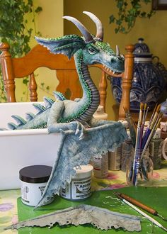 A Posable Dragon - A Creative Journey This tutorial is meant to share how I made my posable cloth dragon. It does not include patterns, nor does it go into step-by-step detail. It's just meant to share techniques, and possibly give the viewer ideas on how to create their own unique dragon.