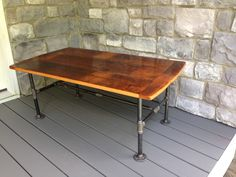 """Reclaimed Coffee table is made from the floorboards of an 1800's log home built in Lititz, PA. The table measurements are 4ft long by 27"""" Wide by 19"""" tall. It has a clear finish on it to protect the s"""
