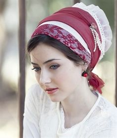 From mitpachat.com here's a stunning photo of a gorgeous tichel in shades of red. Lace and pearls too! [I love the way the fabric flutters out at the back- Sarie]