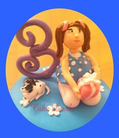 little girl with her dog cake topper