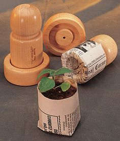 Eco-PotMaker... This nifty eco-friendly mold transforms strips of ordinary newspaper into biodegradable seed-starting pots you plant right in the garden... They work well !