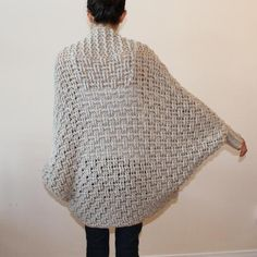This over-sized cardigan is super cozy. It features a textured basket-weave body, a textured, generous shawl collar, dolman sleeves and ribbed cuffs. It looks great paired with leggings or skinny jeans. Shrug Knitting Pattern, Cardigan Pattern, Crochet Cardigan, Knit Or Crochet, Crochet Scarves, Crochet Shawl, Crochet Clothes, Crochet Stitches, Knitting Patterns