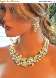 A personal favorite from my Etsy shop https://www.etsy.com/listing/113115509/bridal-statement-bridal-bib-necklace