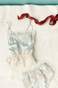 i'm in love with pretty much everything on this site: http://www.bhldn.com/shop_attire_underpinnings/calais-lace-cami