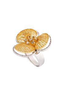 Ring from the Flora collection. It´s spring time and the flowers are the perfect inspiration for this season.  As a celebration of the forms of nature, this ring from the Flora collection is a delicious combination of petals in handmade filigree with a diamond pave giving the piece a light and graceful shine. In yellow and white gold this delicate piece is completed with brilliant cut diamonds