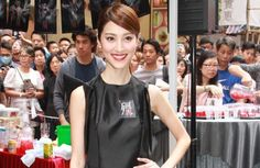 Grace Chan is accused of prioritizing her love life over her work, often being late to events.