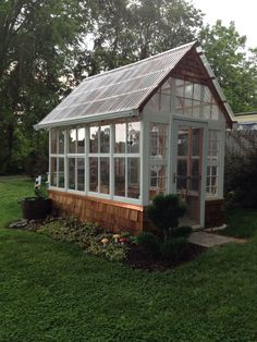 This is a 7'x12' greenhouse I made out of old windows from my home, I used poly-carbonate plastic roof panels and cedar shakes.