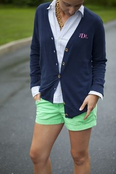 Love this combination of navy with green shorts, of course the monogram and chunky gold chain.