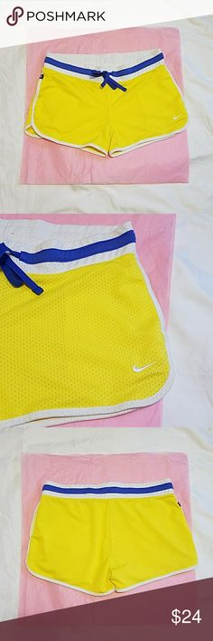 Nike. the athletic dept. Shorts. Nike.the athletic dept.shorts.Size medium.Color yellow,white and blue.used but in a good  condition.Has two pockets on the front.Very good condition. Nike Shorts