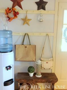 "How to create the perfect ""Drop Zone"" in the mudroom or entryway."