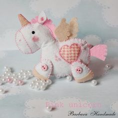 Felt pegasus and felt unicorn for baby mobile? Not using pink though, perhaps bright blue or yellow?
