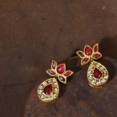 A plethora of chic baubles rendering perfect blend of Regal aristocracy and free spiritedness of the modern world. Shop our Exclusively… Small Gold Hoop Earrings, Gold Jhumka Earrings, Gold Earrings Designs, Gold Jewellery Design, Crystal Earrings, Gold Jewelry, Gold Necklace, Baby Jewelry, Jewellery Rings