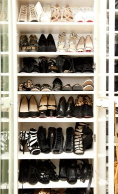 Use Billy bookcase from Ikea and add doors.  Viola, beautiful shoe storage!