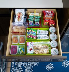 Clear a pantry shelf that's low enough for your kids to reach. That way everyone can help themselves to snacks like granola bars, dried fruit, packs of nuts, and other healthy treats. Keep small snacks corralled in clear plastic bins without lids so that you can see at a glance what's stored inside.   - GoodHousekeeping.com