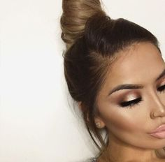 Top knot, beautiful contour and a nude lip.