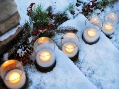 Holiday decor- line your steps leading to your front door with tealights set in hurricane vases! #BBWHoHoHome