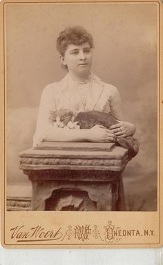 Vintage Photo:  Lady posed with her cat cradled in her arms