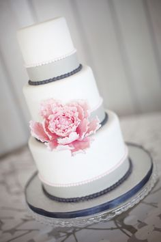 Modern Charcoal Grays Softened by a Single Pink Peony Highlight this Simple White Wedding Cake.  Photo by: millieholloman.com