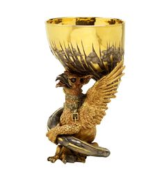Kevin Coates, the Carrington Cup, 1987.  The Director of the V&A, Sir Roy Strong, commissioned this cup for Lord Carrington, the Chairman of the Museum's Trustees. The mythical beast that supports it is a gryphon, with the head of an eagle and the body of a lion. This creature was carefully chosen. It was a guardian of treasure, and Lord Carrington was a guardian of the wealth of treasure that is the V&A's collection.