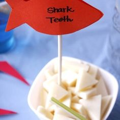 Cut white cheese as triangles - shark teeth for pirate themed party
