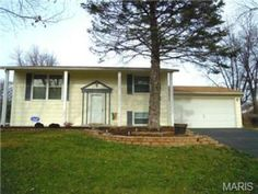 wonderful split level home with attached 2 car garage
