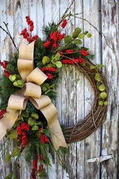 Christmas Grapevine wreath filled with red berries, pine & tied with a burlap bow, a beautiful natural way to decorate for the holiday season!