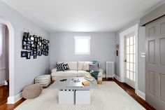 Minimal furniture, a smart game table that expands, light colors, and floor pillows make this a great space to relax, hang out, or play games.