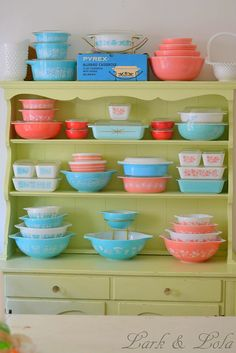 Pretty pink and turquoise Pyrex collection in sweet green hutch