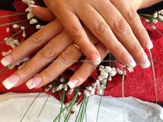 Acrylic nails with white tips swarofski crystals on ring fingers