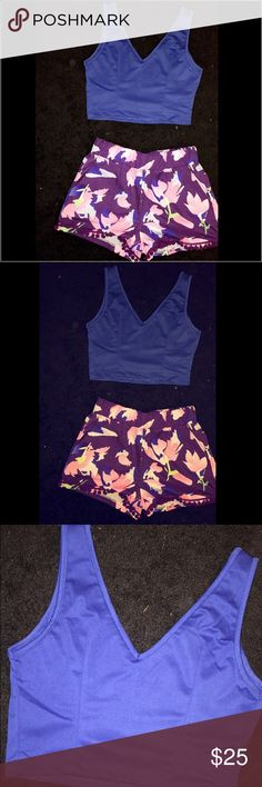 2 Piece Floral Set 2 piece floral top and bottom set. Blue tank crop top. Purple floral shorts. Very comfortable. High quality. Never worn. New without tags. Perfect for summer. Other