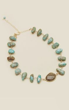Add the perfect touch to your boho look with this Planet Blue Exclusive Good Vibes Choker by Natalie B. Featuring genuine turquoise with a Labradorite center stone wired wrapped in 14kt gold. Perfect for letting it stand on its own or layering with your other favorite Natalie pieces. This necklace is made with a natural stone. Shading, size, and color may vary. Made in Los AngelesGenuine Turquoise, 14kt Gold Filled Wire, Labradorite13.5