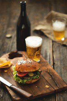 A burger with a bottle of beer a good combination.