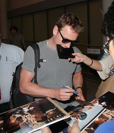 Michael Fassbender is being escorted out from the Toronto Airport, where is stopped to give away a few autographs to fans. He is there to attend The Toronto International Film Festival. - Michael Fassbender is being escorted out from the Toronto Airport, where is stopped to give away a few autographs to fans