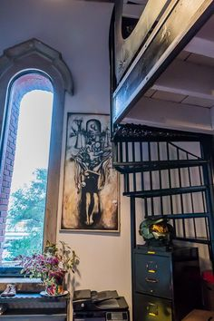 I NEED THAT ARTWORK!! Marco & Ilse's Gothic Industrial Loft