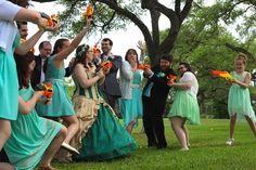 """""""When we asked everyone to pick out their weapon of choice for the Wedding Party Nerf War, our flower girl picked the ridiculously large shotgun..."""""""