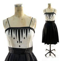 70s Beaded Taffeta Cocktail Dress in Graphic Black and White by Nancy Bracoloni for Shangri-la. $38.00, via Etsy.
